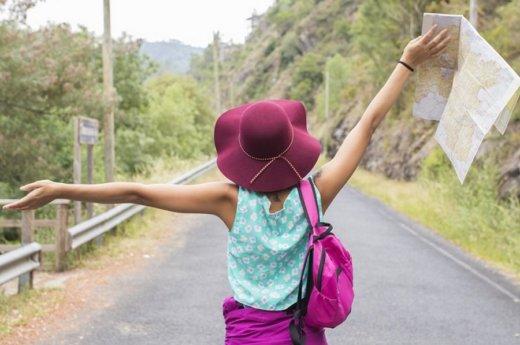 girl enjoying outdoors with arms aloft